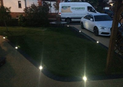 Carnock resin drive at night with driveway lights installed